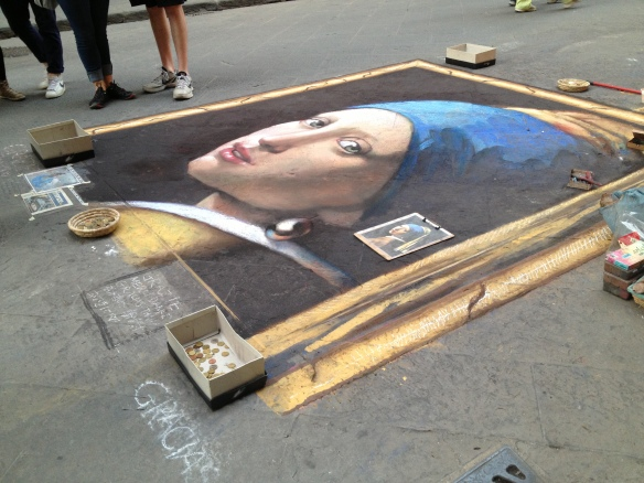 A couple guys did this on the street with what looked like crayons. Then they washed it away the next day and did a different painting. Cray.