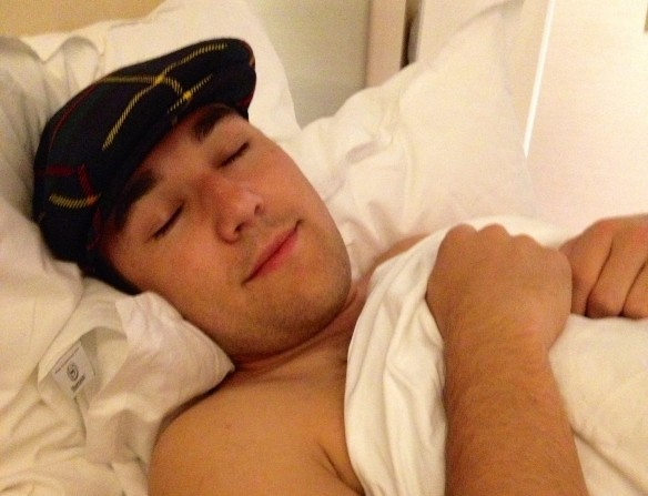 Me, sleeping in my new favorite hat. It makes me look Scottish...